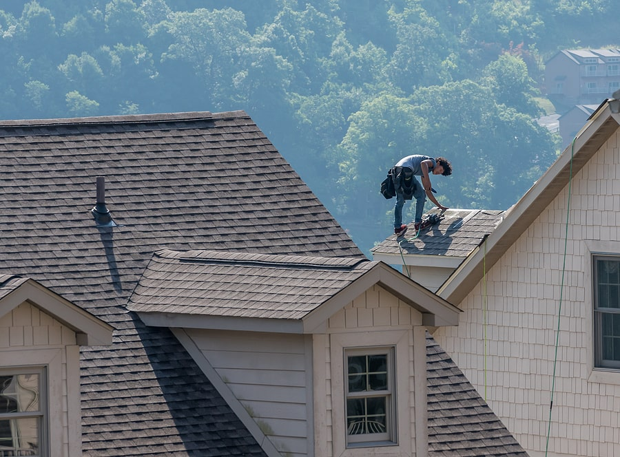 professional roof leak being repaired